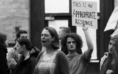 Women gather in protest against pseudoscience author Charles Murray at Middlebury College
