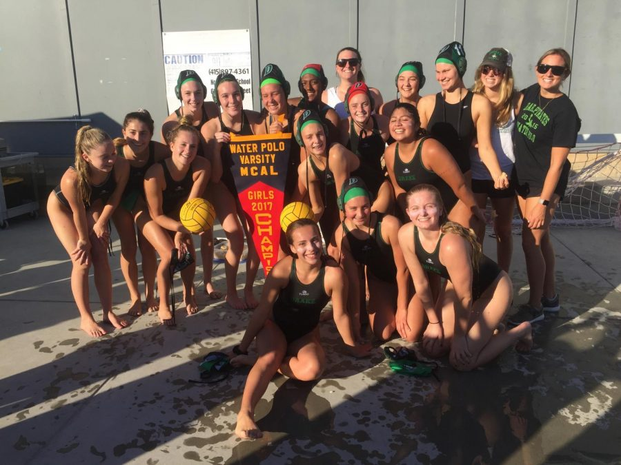 The Water Polo girls celebrate winning the league title game.