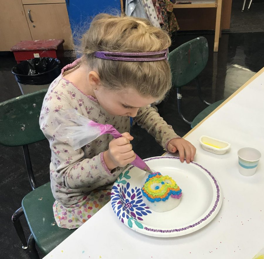 An evacuated girl makes a sugar skull for Dia de los Muertos at Open Classroom in San Geronimo on Oct. 17, 2017