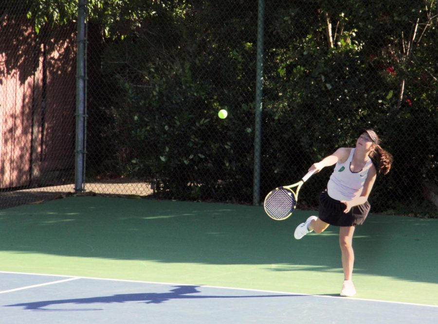 Girls' varsity tennis faces wasps and the wind in nail-biting match