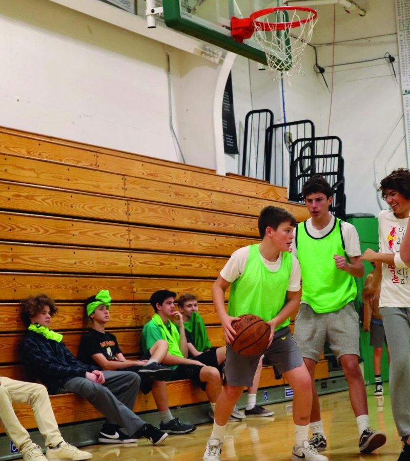 Some students play basketball in PE, while others sit by and watch, showing both sides of the enthusiasm spectrum