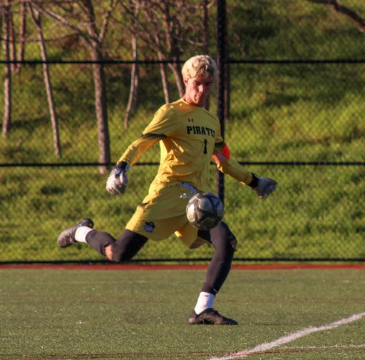 Junior Ronan Axelson kicks ball out of goalie box.