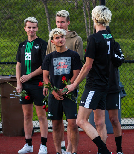 Senior players thank their parents and present roses after the game. (From the left: Griffin Waite, Erik Hargedahl, Keoni Schubert, Logan Smith)