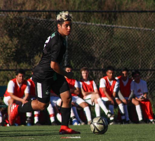 Junior Luis Escobar gears up for a pass.