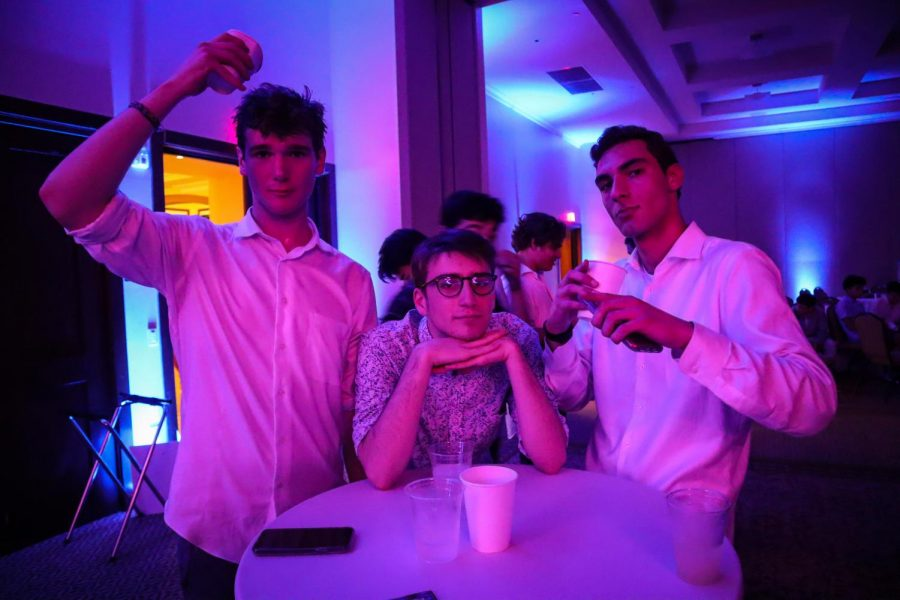 Henry Sutro, Kaden Brastow, and Will Statz are exhausted towards the end of Winter Formal, and take a break from dancing.