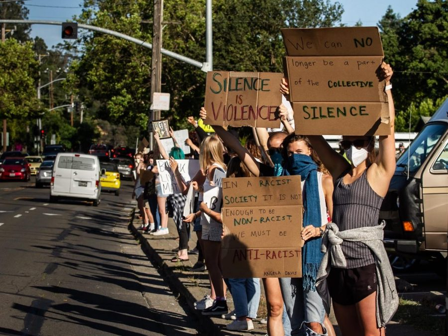 Members of the community protesting for Black Lives Matter on the side of the street in front of High School 1327 on June 10.