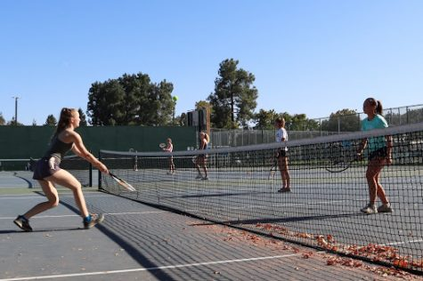 Girls water polo team practicing on the tennis courts for their last practice of the season.