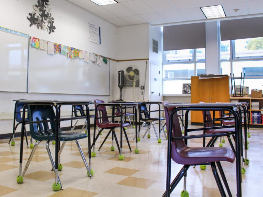 A look at social distanced desks in room 224 for hybrid school.