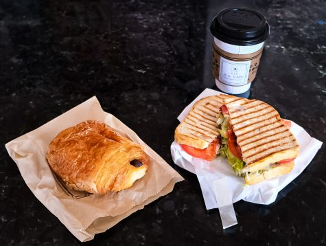 Caption: D.G. Cafe's delightfully scrumptious triple shot latte, chocolate croissant, and Mt. Baldy BLT, waiting to be devoured.