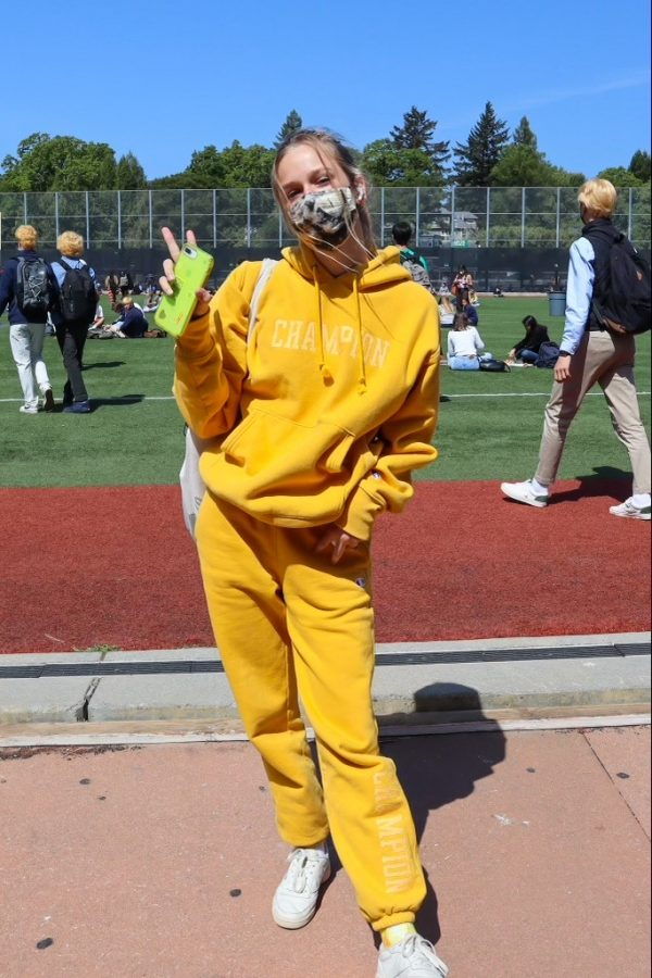 Senior Liza Dern poses in a matching yellow sweatsuit for pajama day.
