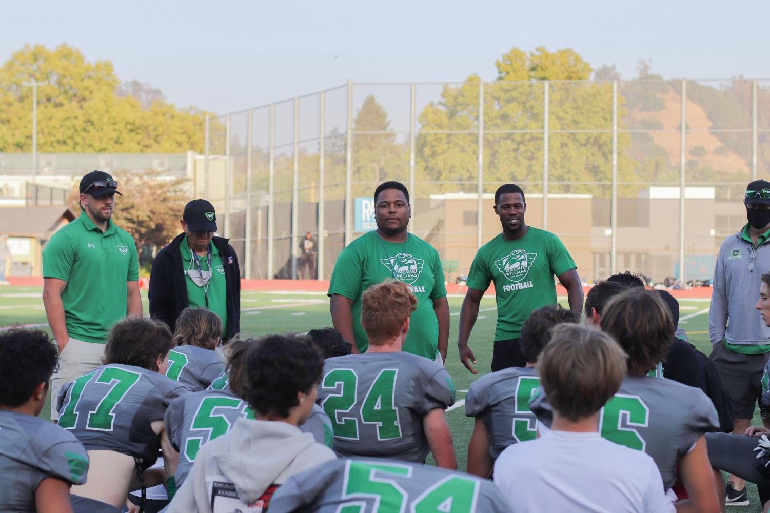 Archie Williams head coach, Anthony Jackson (middle) and his staff (from left to right) Joe Spring, Jack Ruach, Dee Anderson, and Rafael Alonso talking to their players after a victory against Berean Christian