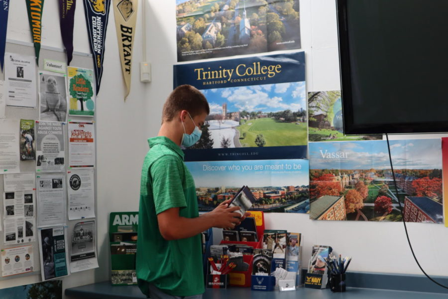 Haakon Lacy, AWHS sophomore views a brochure in the College & Career Center.