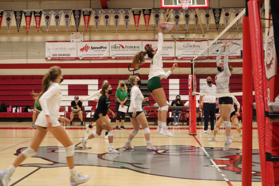 Josie Griffiths spikes the ball into the opposing team's court and scores a point for the Falcons.