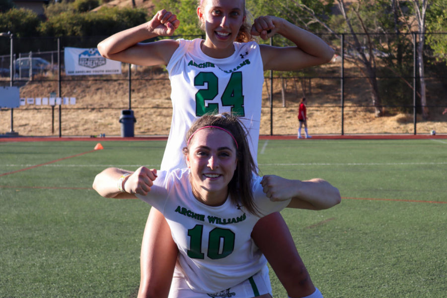 Junior Zola Thurston sits on Senior Jada Shore's back to celebrate their effort in the game.