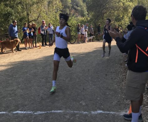 AWHS cross country races through the Concrete Pipe trail