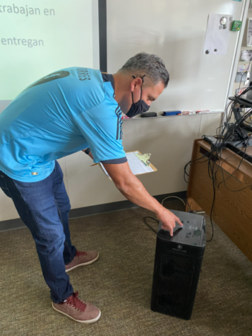 Senor Jose Anchordoqui turning on his classroom's Medify air purifier, identical to what should be in every classroom.