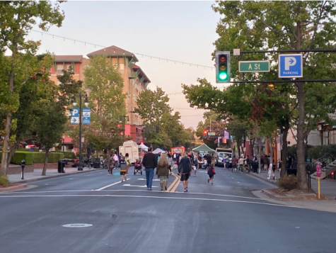 People walk towards the busy food trucks and music coming from 4th Street in Downtown San Rafael.
