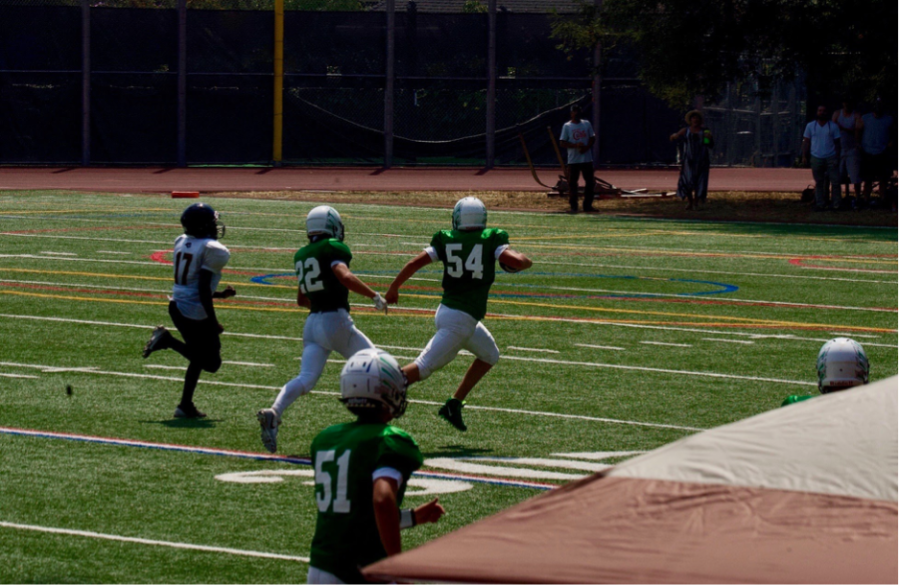 Sophomore+Axl+Yarbough+picks+up+a+fumble+and+runs+for+the+end+zone+during+the+Salesian+College+Preparatory+game+on+Aug.+28.