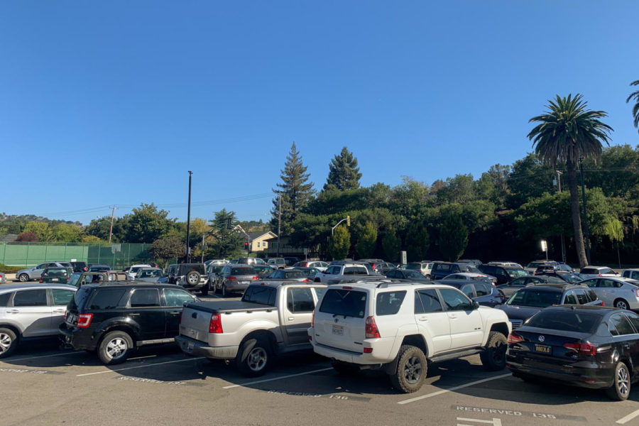 An early morning at the AWHS front parking lot where student vehicles fill up every spot.