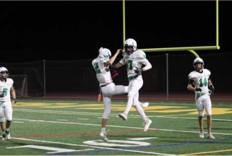 Senior wideout Max Henzl (#17) celebrates his second touchdown of the game with teammate Will Roberts (#12). Henzl's 58-yard catch and run was the focal point for the Falcons offense in a 48-20 losing effort.