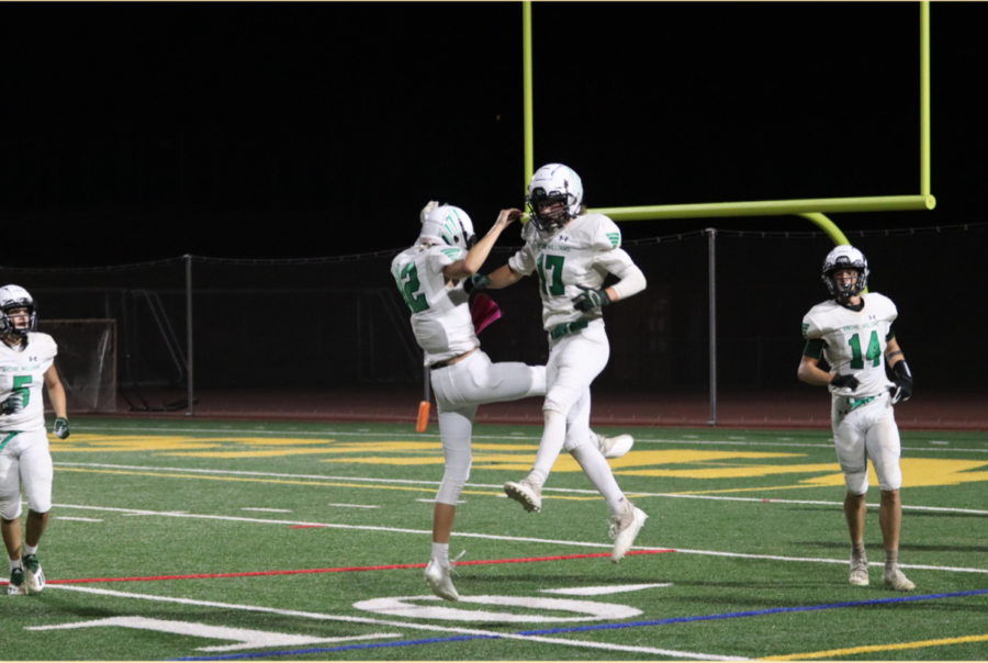Senior+wideout+Max+Henzl+%28%2317%29+celebrates+his+second+touchdown+of+the+game+with+teammate+Will+Roberts+%28%2312%29.+Henzl%E2%80%99s+58-yard+catch+and+run+was+the+focal+point+for+the+Falcons+offense+in+a+48-20+losing+effort.