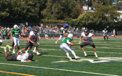 Junior varsity running back takes the ball upfield during Saturday's game in San Anselmo.