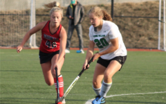 Katharine DiPerna Pavlich, midfielder and AWHS junior, steals the ball from the Giants' offensive player during the first half of the game on Friday, Oct. 22.