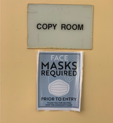 """Sign reading """"Face masks required prior to entry"""" pictured at the Brookside Elementary School Copy Room."""