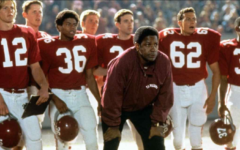 Coach Boone and team watch nervously as they play their rivals under the stadium's lights. Promotional material courtesy of Jerry Bruckheimer Films.