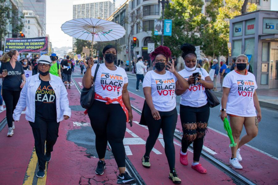 Members of Black Women Organized for Political Action march side by side.